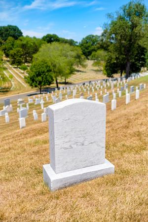 tombstones: Tombstones on a grassy hill at Arlington National Cemetery near Washington D.C. Stock Photo