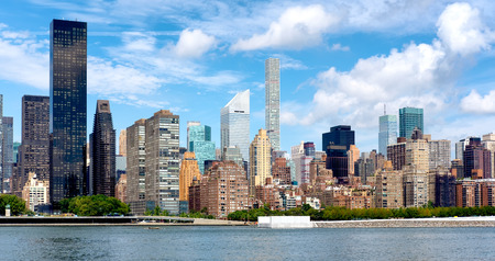 city buildings: Old apartment buildings and modern skyscrapers in midtown Manhattan, New York City Stock Photo