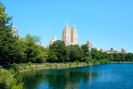 Summer scene at Central Park in New York City with the Jacqueline Kennedy reservoir and the Central Park West skyline