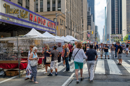 Traditional street fair at 6th Avenue next to the Radio City Music Hall in New York City