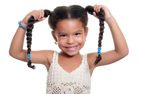 braid: Portrait of a cute and funny  african american small girl isolated on a white background