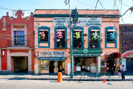 colonial building: Local businesses at a colorful colonial building in Coyoacan, a historic neighborhhod in Mexico City Editorial