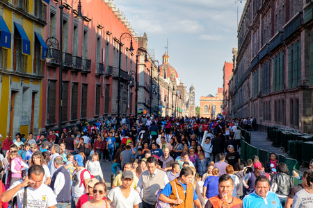 Huge crowd and colorful buildings at the historic center of Mexico City