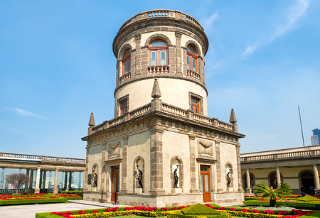 Beautiful gardens and the Caballero Alto tower on top of Chapultepec Castle in Mexico City