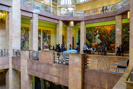 artdeco: Visitors admiring the famous mural paintings at the museum of Palacio de Bellas Artes in Mexico City Editorial