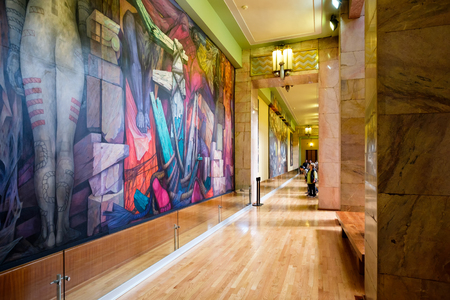 Visitors admiring the famous mural paintings at the museum of Palacio de Bellas Artes in Mexico City