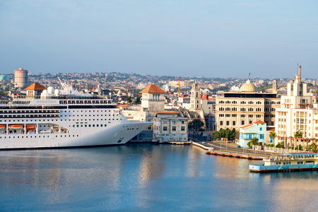 docked: Panoramic view of the  historic center of Havana with a cruise ship docked at the bay