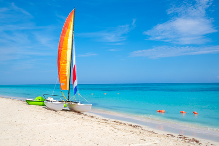 The tropical beach of Varadero in Cuba with a colorful sailboat on a summer day with turquoise water Stok Fotoğraf