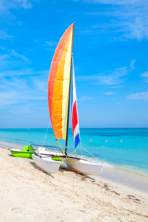 The tropical beach of Varadero in Cuba with a colorful sailboat on a summer day with turquoise water Stock Photo