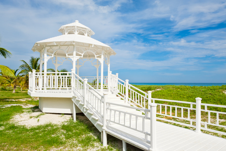 varadero: White wooden pavilion with a view of the beautiful beach of Varadero in Cuba