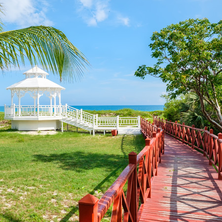 Wooden walkway leading to the shore at the beautiful beach of Varadero in Cuba