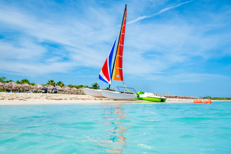 Sunny day at Varadero beach on the island of Cuba with a colorful sailboat Stock Photo