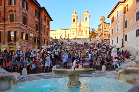 The famous Spanish Steps and the Trinita dei Monti church at Piazza di Spagna in central Rome at sunset