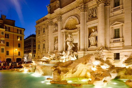 The famous Trevi Fountain illuminated at night in Rome, Italy Stock Photo