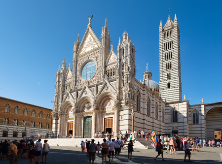 SIENA,ITALY - JULY 23,2017 : Tourists and locals next to the Cathedral of Siena in Tuscany, Italy