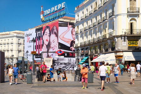 Tourists and locals at Puerta del Sol, one of the busiest and most well known places in Madrid