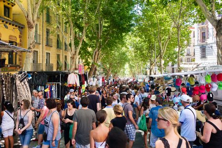 People shopping at El Rastro, the most popular open air market in Madrid