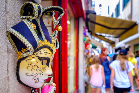 typical: Traditional carnival masks for sale on a souvenir shop in Venice, Italy