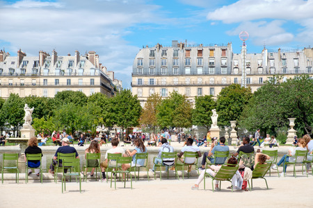 Parisians relaxing at the Tuileries Garden on a beautiful summer day in Paris