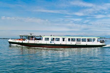 water bus: Vaporetto or water bus on the lagoon of Venice Editorial