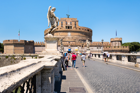 castel: Tourists at Ponte Sant Angelo in Rome with the imposing Castel Sant Angelo on the background Editorial