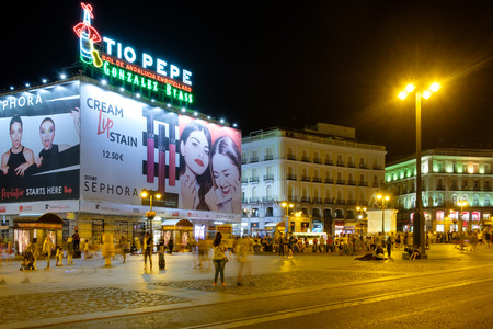 MADRID,SPAIN - AUGUST 8, 2017 : Puerta del Sol at night, the most well known and busiest place of Madrid Editorial