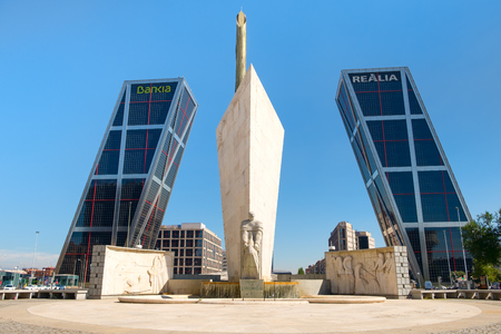 The Monument to Calvo Sotelo and the skyscrapers known as the Gates of Europe in Madrid Sajtókép