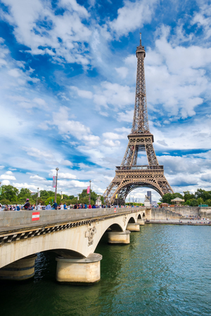 The Eiffel Tower and the bridge crossinf the river Seine in Paris on a beautiful summer day