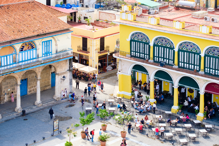 Colonial buildings and outdoor restaurant in Old Havana
