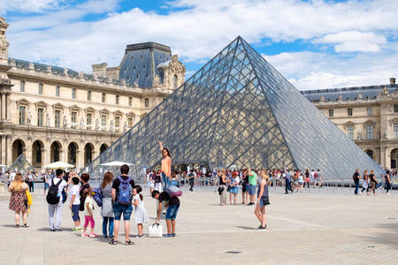 The Louvre Museum in Paris on a beautiful summer day