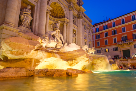 The famous Fontana di Trevi in Rome illuminated at night Editorial