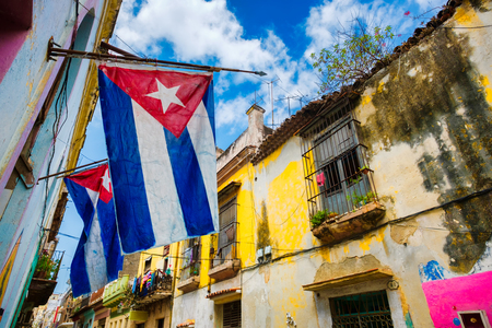 Cuban flags and colorful decaying buildings in Old Havana