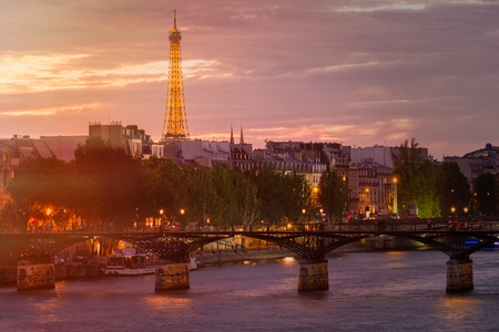 The city of Paris at sunset with a view of the bridges over the river Seine