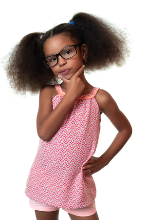 Cute african american small girl thinking with a funny expression - Isolated on white