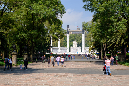 Mexican families visiting the  Heroic Cadets Memorial at Chapultepec Park Редакционное