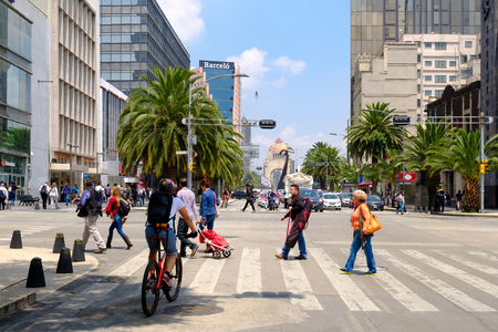 Urban scene in Mexico City with the Monument to the Revolution on the background