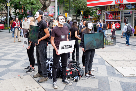 Anonymous activists protesting againt cruelty to animals in the food industry Imagens - 105848616