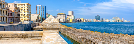 The famous seaside Malecon wall and the skyline of Havana on a beautiful summer day Фото со стока