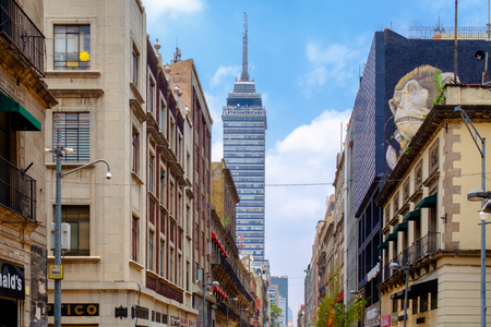 Old buildings and the modern Latinamerican tower in the historic center of Mexico City Фото со стока