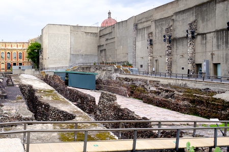 Pre-hispanic ruins of the aztec city of Tenochtitlan situated on the modern Mexico City Фото со стока