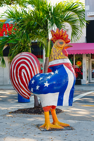 MIAMI,UNITED STATES - DECEMBER 3,2018 : Rooster with the cuban and american flags at the famous 8th street in Little Havana