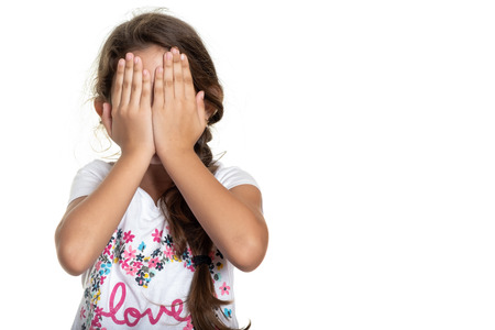 Hispanic small girl covering her face with her hands - Isolated on white 免版税图像