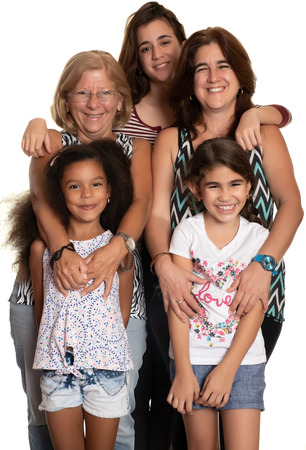 Multiracial family hugging, Grandmother, mom and her three mixed race daughters - Isolated on white Фото со стока