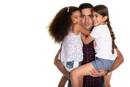Multiracial family, Hispanic father with a funny expression hugging his two mixed race daughters - Isolated on white Фото со стока
