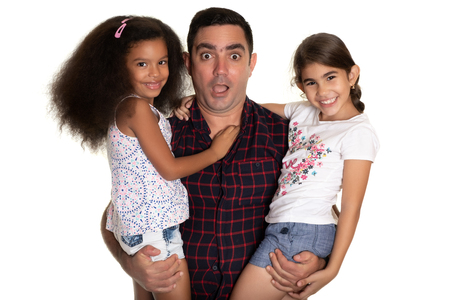 Multiracial family, Hispanic father with a funny face hugging his two mixed race daughters - Isolated on white