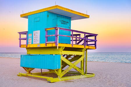 Famous lifeguard tower at South Beach in Miami with a beautiful sunset sky