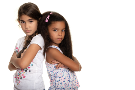 Two sad and angry small girls  - Isolated on white Imagens
