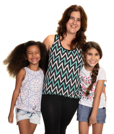 Mom hugging her mixed race daughters - Isolated on white