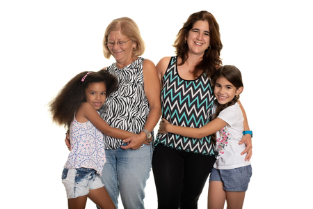 Multiracial family - Mom and grandmother hugging their mixed race daughters - Isolated on white