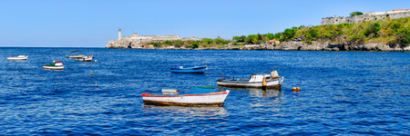 The bay of Havana with small fishing boats on a beautiful summer day Фото со стока